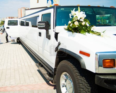wedding big limousine waiting for newlywed