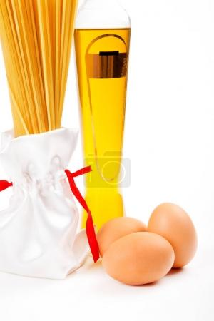 Italian pasta with olive oil and eggs on white background