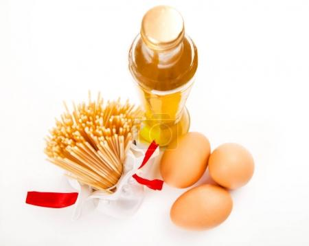 Italian pasta with olive oil and eggs on white background above