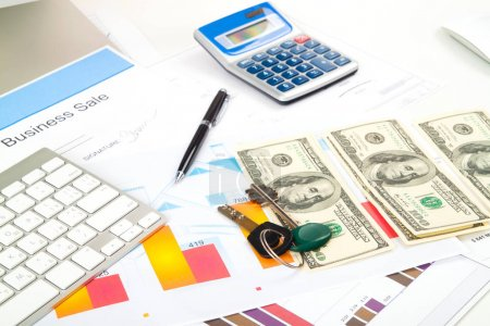 accounting. business deal with key and money