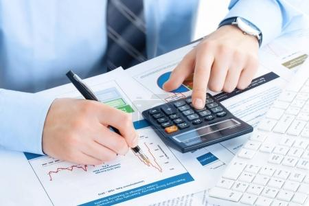business man at workplace with tablet pc