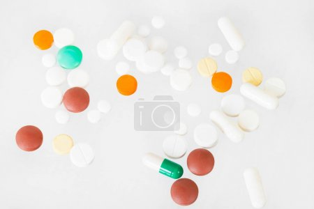 collection of pills and capsules isolated on white background