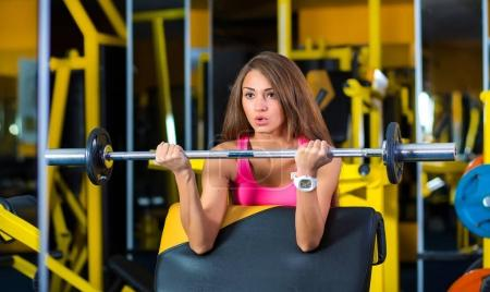 Photo for Woman in gym lifting weights - Royalty Free Image