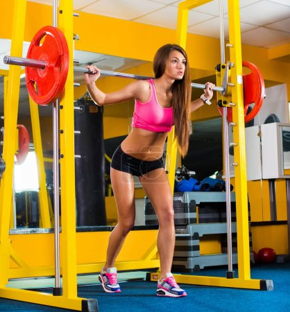 attractive young woman is engaged in fitness sport club