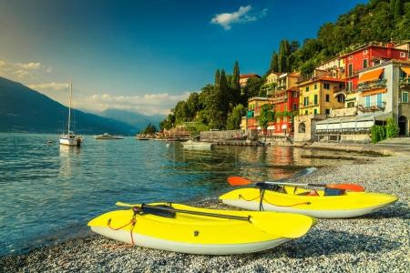 Wonderful cityscape and harbor with yellow kayaks, Varenna, Lake Como