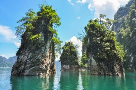 Huge limestone cliffs rising out of open lake at Khao Sok Nation