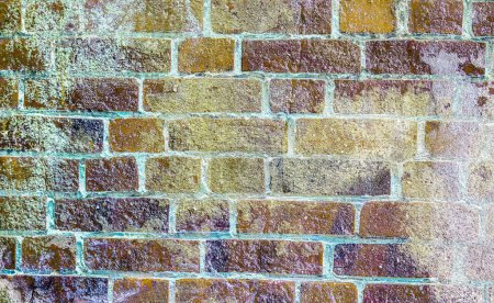 Detailed close up view on aged and weathered brick...