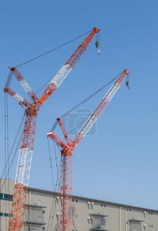 Photo for Closeup big red crane at construction site - Royalty Free Image