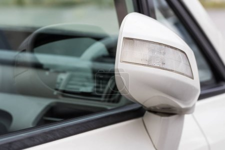 Side rear-view mirror closed for safety at car park