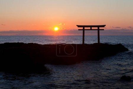 Sunrise and sea at Japanese shinto gate in Oarai city, Ibaraki prefecture