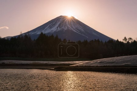 Winter Fuji Diamond , view of the setting sun meeting the summit of Mt. Fuji