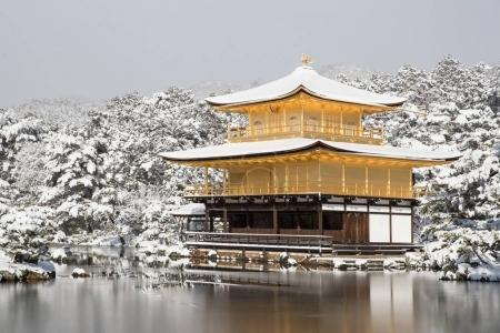 Zen temple Kinkakuji ( Golden Pavilion ) with snow fall in winter 2017. Kinkakuji is one of Kyotos leading temples and Recognized by UNESCO as a World Cultural Heritage