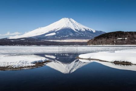 Mountain Fuji with reflection and Yamanakako ice lake in winter