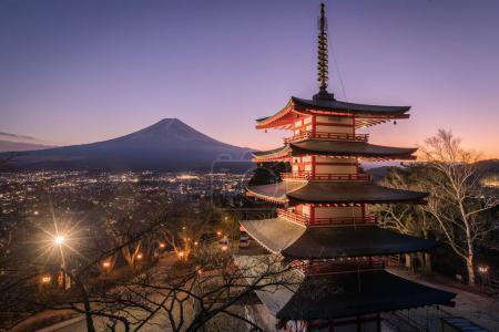 view of Chureito Pagoda and Mount Fuji on sunset background