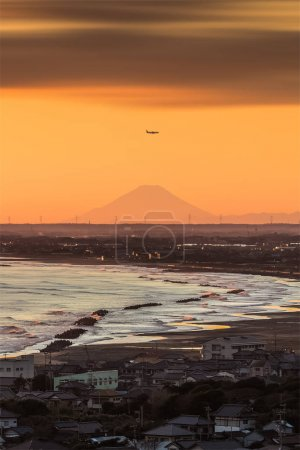 Flying airplane over city and  Mount Fuji