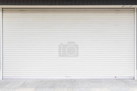 White metal roller door shutter
