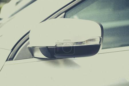 Close up of white car mirror