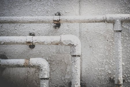 Old construction of metal water pipes