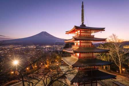 view of Chureito Pagoda and Mount Fuji on sunset background