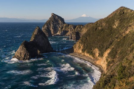 Sengamon Rock, mountain Fuji and Japanese sea in winter seen from Izu city, Shizuoka prefecture, Japan.