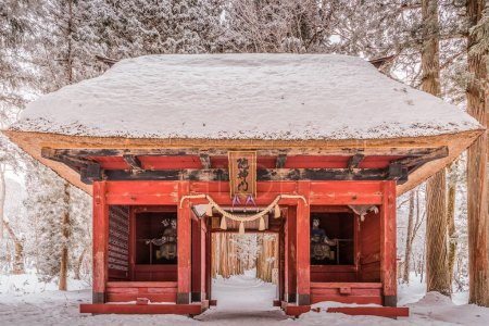 Japanese shrine gate in snow day
