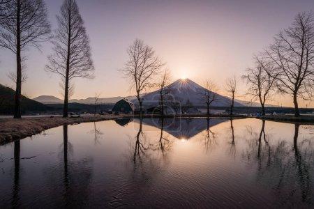 Diamonf Fuji seen from Fumotopara camping ground, Fujinomiya , Shizuoka prefecture. Diamond Fuji is View of the setting sun meeting the summit of Mt. Fuji