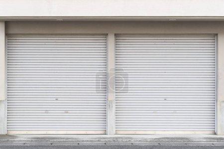 Closed white roller shutter door