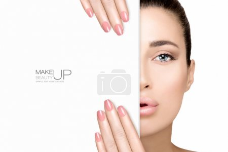 Photo for Beauty Makeup and Nai Art Concept. Beautiful fashion model woman with soft pink smoky eye makeup, foundation on a unblemished skin and trendy pink lipstick to match her manicured nails, half face with a white card template. High fashion portrait isol - Royalty Free Image