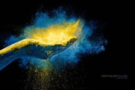 Photo for Closeup of hand holding colorful holi powder surrounded by a vibrant color explosion with falling powder over a black background with copy space. Festival of colors - Royalty Free Image