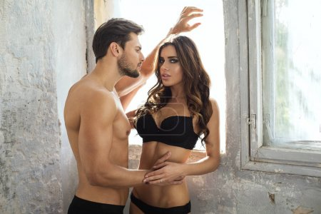 young beautiful couple in lingerie