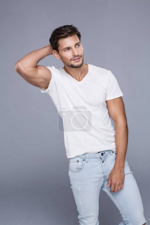 Handsome man wearing jeans