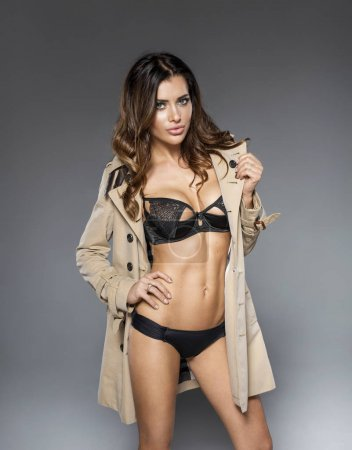 woman in coat and underwear