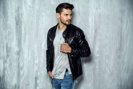 man in leather jacket standing