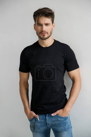 man in black t-shirt looking at camera