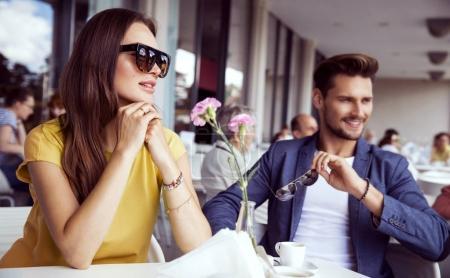 Beautiful couple sitting in restaurant