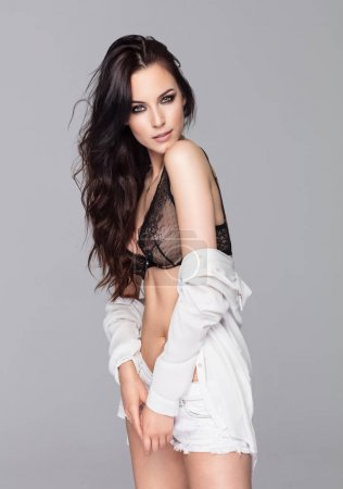 model in white clothes and black bra
