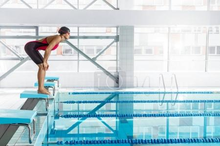 Photo for Professional woman swimmer in a starting position - Royalty Free Image