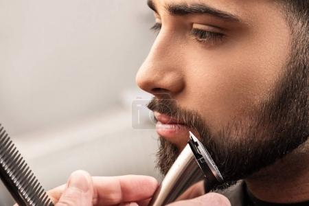 Shaving beard with a hair-clipper