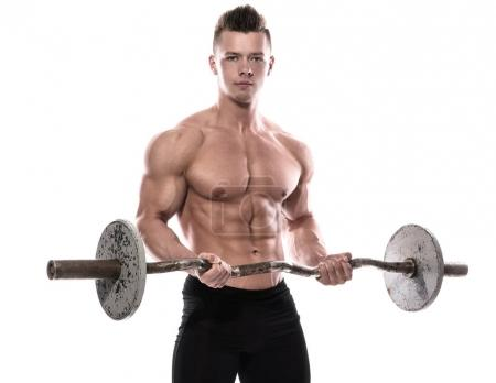 Photo for Young bodybuilder with barbell in studio - Royalty Free Image