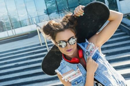 Stylish girl with a skateboard