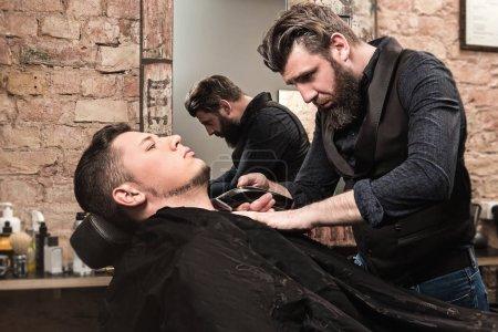 Shaving beard with a hair-clipper