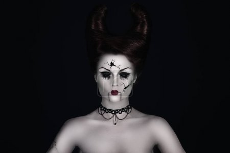 broken doll with horns