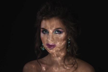Beautiful woman in darkness
