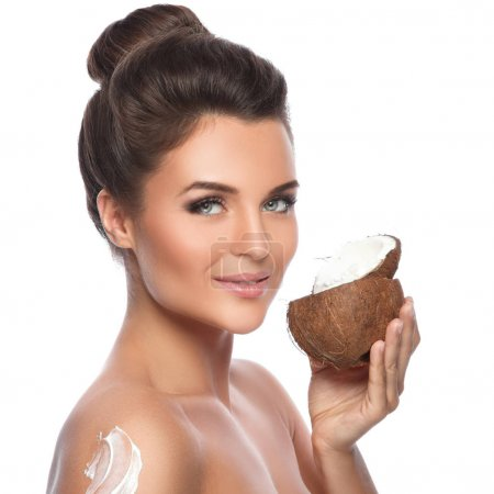 woman with coconut and moisturizing cream