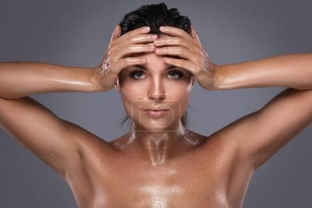 young woman with oiled skin