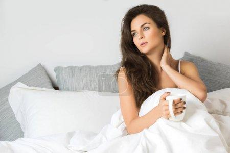 Sick woman under blanket