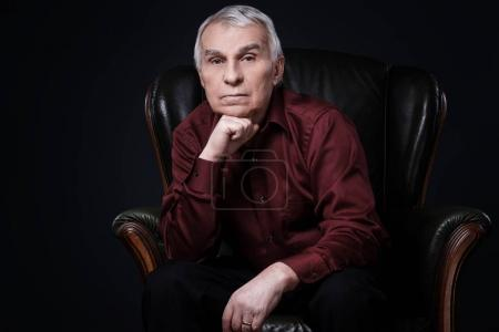 Photo for Portrait of Senior man in armchair - Royalty Free Image