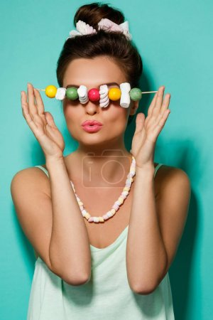 woman with sweet candies on skewer
