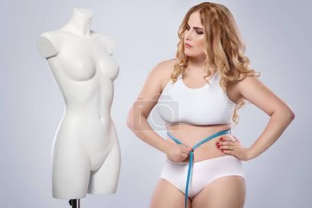 model and dummy female torso