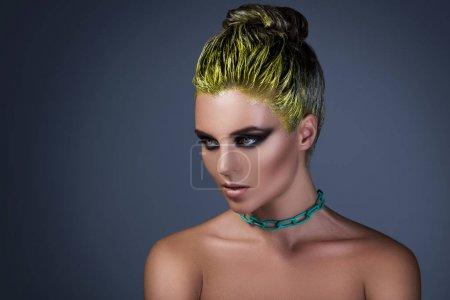 stylish girl with yellow hair